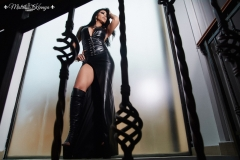 Mistress Kennya  in leather dress and open leather boots