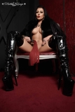 Mistress Kennya with boots and  fur holding her whip