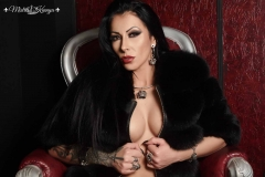 Mistress Kennya on her throne with fur covering het tits