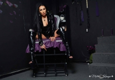 Mistress Kennya with boots shows you your place in the cage