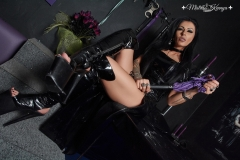 Mistress Kennya with latex dress and boots holding her whip