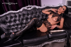 Mistress-Kennya-in-lace-wearing-high-boots-on-couch-MARKED