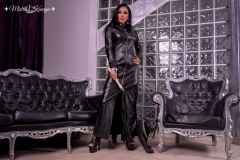 Mistress-Kennya-in-long-eather-dress-with-boots-and-whip-MARKED