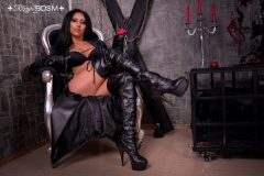 Mistress-Sheyla-sexy-in-black-leather-coat-with-gloves-and-crop-wearing-boots-marked